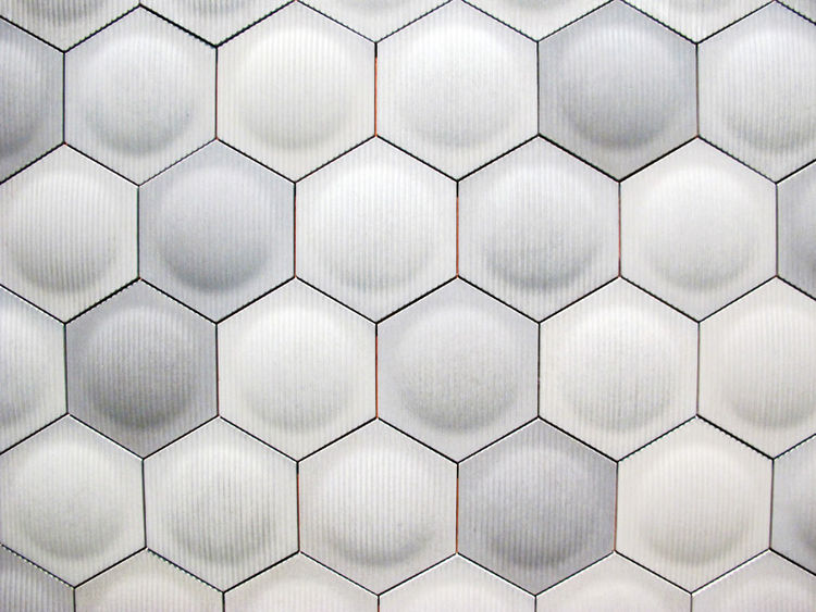 """Lastly, I have to mention one other small booth, one that I spent about 10 minutes touching everything inside it. <a href=""""http://www.ogassian.com/"""">Daniel Ogassian</a> is a Los Angeles based industrial designer who creates these geometric tiles, which in"""