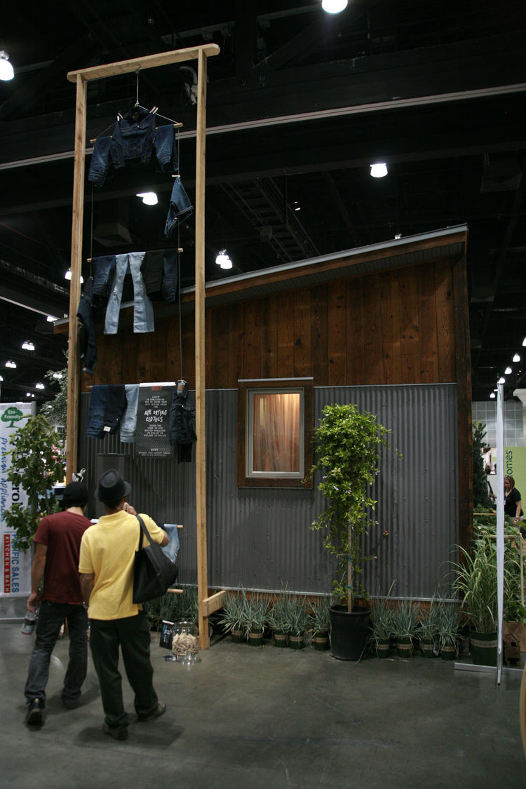 """<a href=""""http://designecology.com/"""">Design Ecology</a>'s prototype drying rack, festooned with Levi's."""