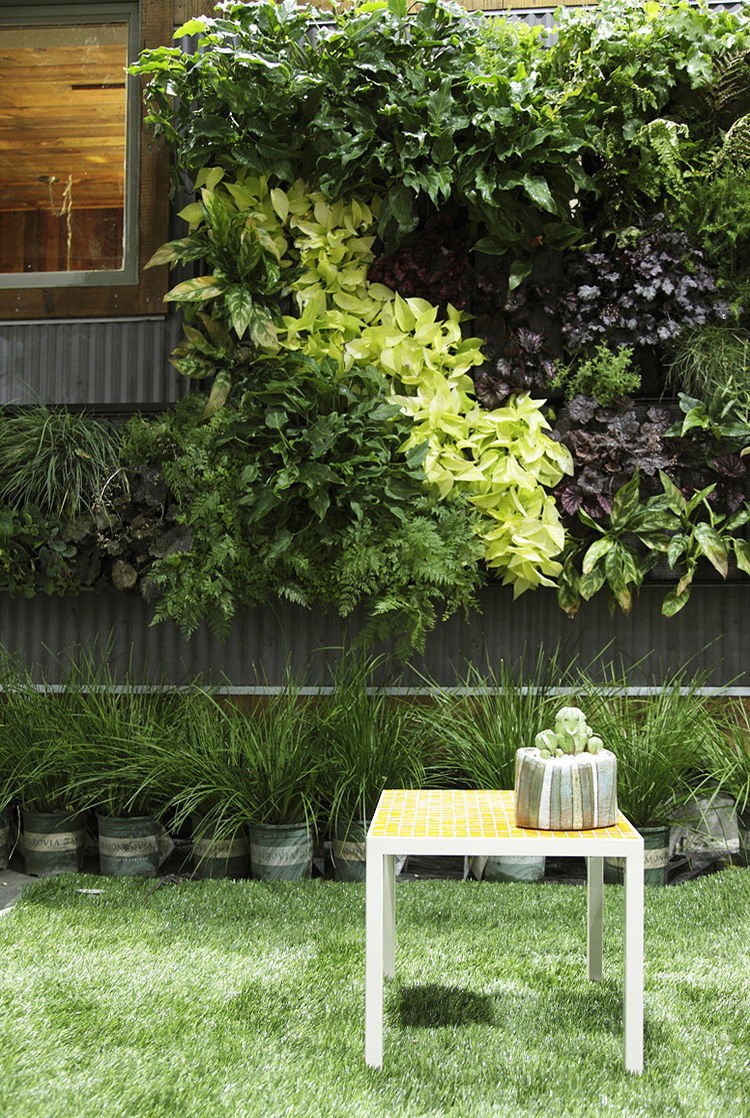 """<a href=""""http://designecology.com"""">Design Ecology,</a> a design-and-install service from the Bay area, installed a vertical garden by <a href=""""http://fytowall.com/default.htm"""">Fytowall</a>. The system has built-in irrigation and works on a grid (the plant"""
