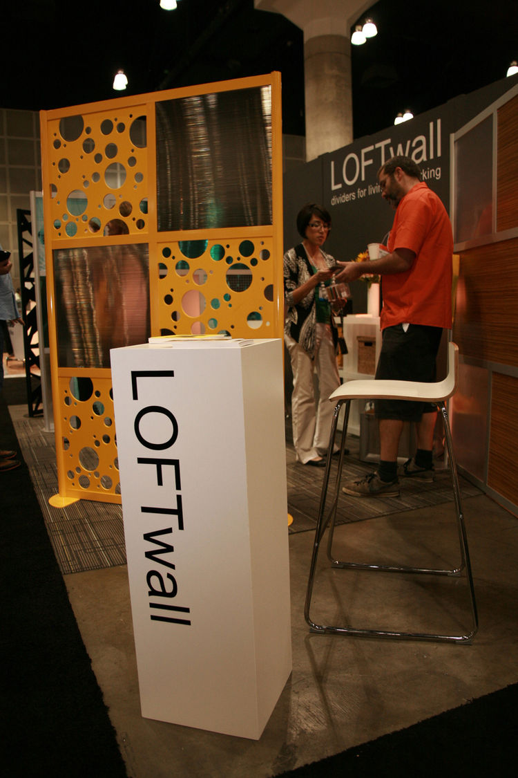 "Dallas-based company <a href=""http://www.loftwall.com/"">LOFTwall</a> turned heads with its bright yellow wall divider on display."