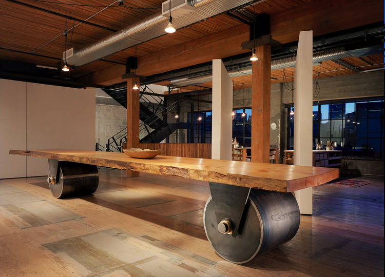"This artist's studio was created out of two bays on the second floor of a former warehouse. Sliding and pivoting 9'x9' wall panels run adjacent to the large central wood beam and allow the 3,750 square-foot space to be reconfigured as needed. A ""working w"