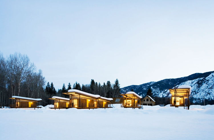 """The Herd"" as they are often referred to, sit out in the open in breathtaking scenery. Tanner Construction collaborated with Tom Kundig on the project for the same client who commissioned Delta Shelter. As the story goes, the rolling huts were zoned for a"