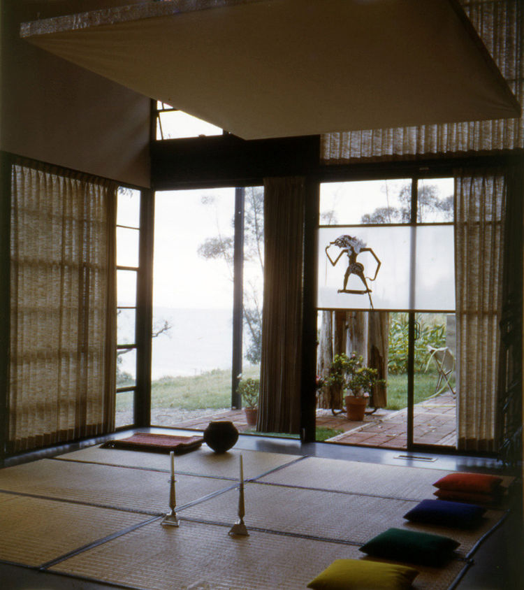 "Another shot from 1950 shows more goza mats and pillows for seating guests. The ocean can be seen beyond the corner window; it is now more obscured by trees. Photo courtesy <a href=""http://eamesfoundation.org/"">the Eames Foundation</a>."