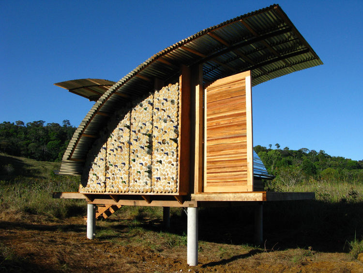 A sideview of the cabana shows off the most artistic facet of the design, where recycled bottles are embedded in the wall.