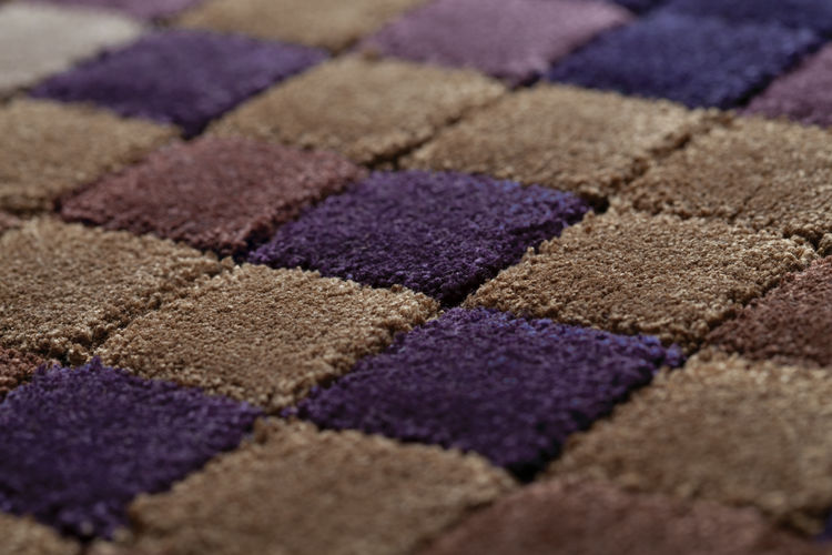Countless hand-tufted squares make up the overall design. Edward Fields' carpets are all handmade. Typically, a single artisan works on a rug from start to end to ensure greater uniformity in the completed product.