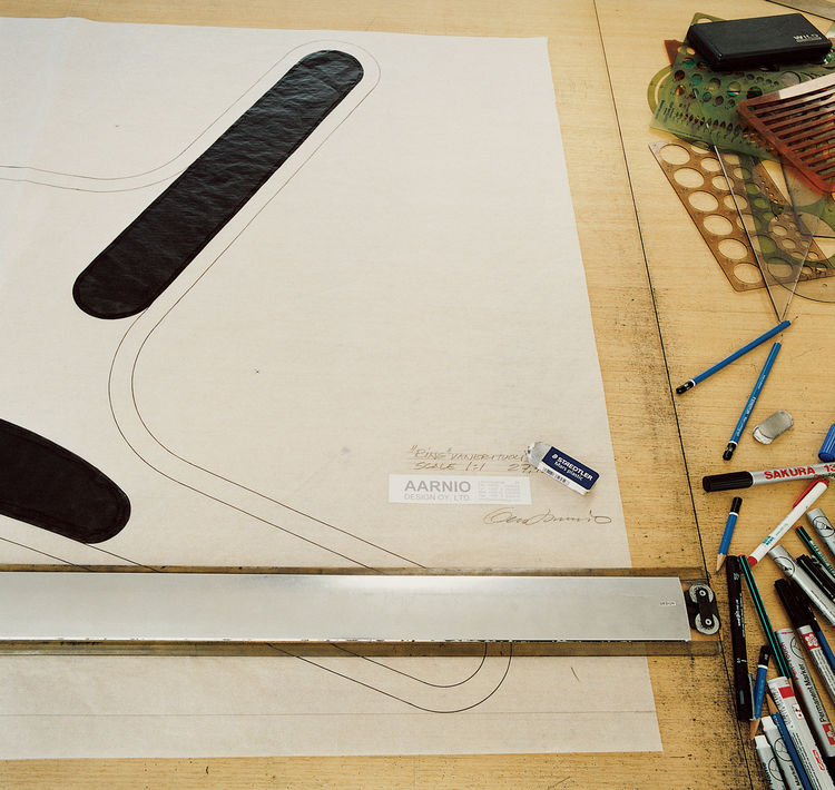 Aarnio works out his designs digitally at a drafting table.