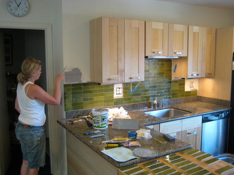 Lynda did all of the tiling work in the kitchen. We used Heath Ceramics second stock tiles and applied them directly to the drywall. Lynda sorted them all by grade and color, and hand assembled the pattern as she went up the wall. She hadn't any construct
