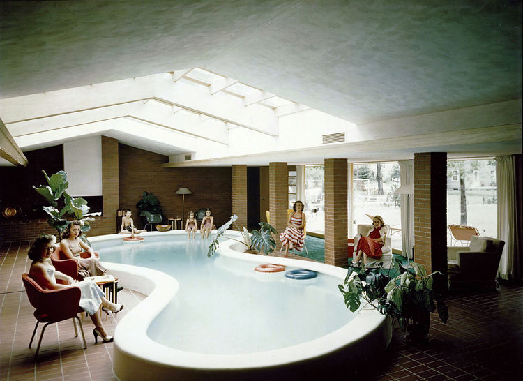 The living room and indoor pool of the Defoe beach house designed by Alden B. Dow.