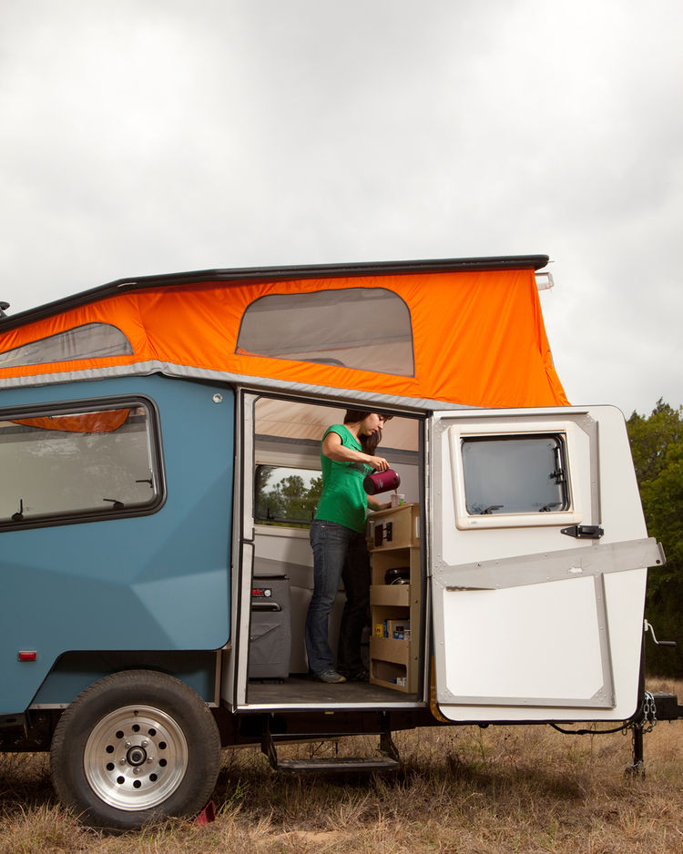 In travel mode, the Cricket Trailer measures 15 feet long, six and a half feet wide, and six feet ten inches tall (ground to roof), but when the top is popped up, it provides six feet two inches of interior headspace.