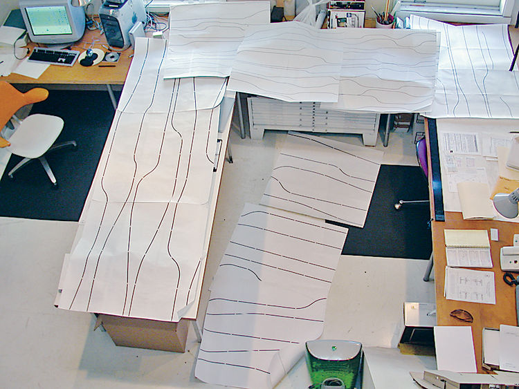 It's one thing to design an apparently random pattern on a computer and print it out; it's another to turn streaming lines into layers of plywood.