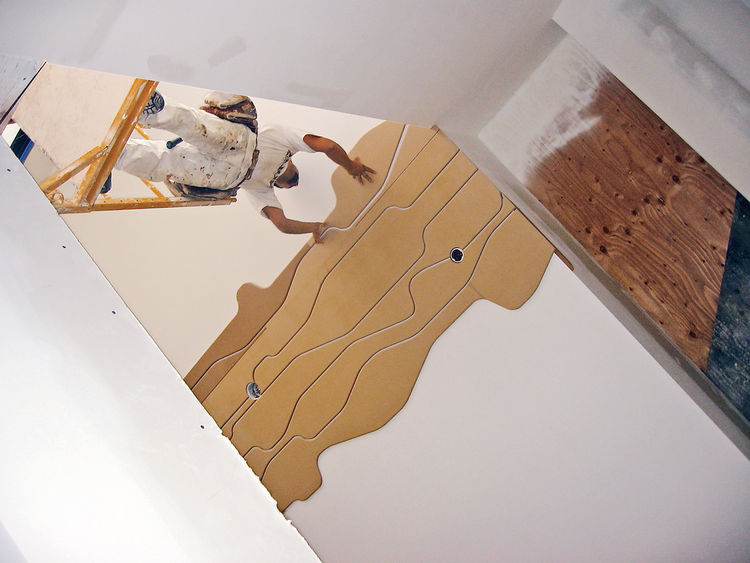 Installation of the ceiling was a laborious six-week process that included the painstaking and evenly spaced assembly of each row of panels, one carefully placed piece at a time. Finally, three coats of white paint were applied as the finishing touch. The