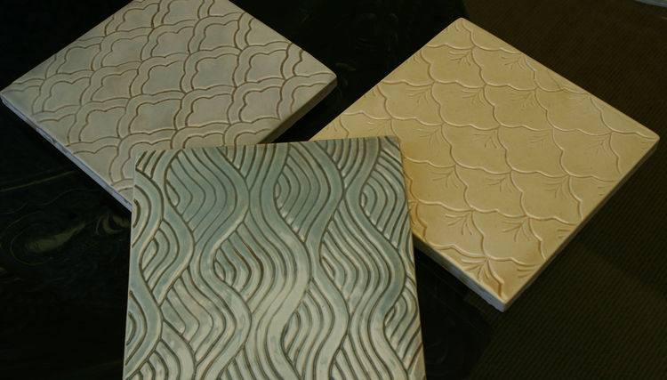 "<a href=""http://www.blueslidearttile.com/"">Blue Slide Art Tile</a> has been making tile for 23 years. Headquartered in Point Reyes, CA, the company's design is clearly affected by the beauty of the surrounding ocean and fog. Their tiles are etched using b"