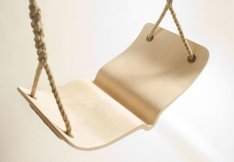 """The """"Fugle"""" swing is inspired by Scandinavian bentwood design. The seat is made out of maple and walnut and the rope is natural hemp. Photo courtesy of Christina Fesmire."""