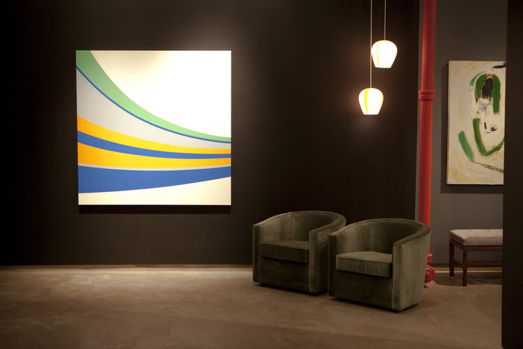 <i>Eodroon</i>, 2005, an acrylic-on-canvas hard-edge painting by Grant Wiggins, at left, and an untitled oil-on-canvas painting by Jason Fitzmaurice, with a pair of 1950s green mohair tub chairs by Edward Wormley for Dunbar. Photo courtesy Elko Weaver.