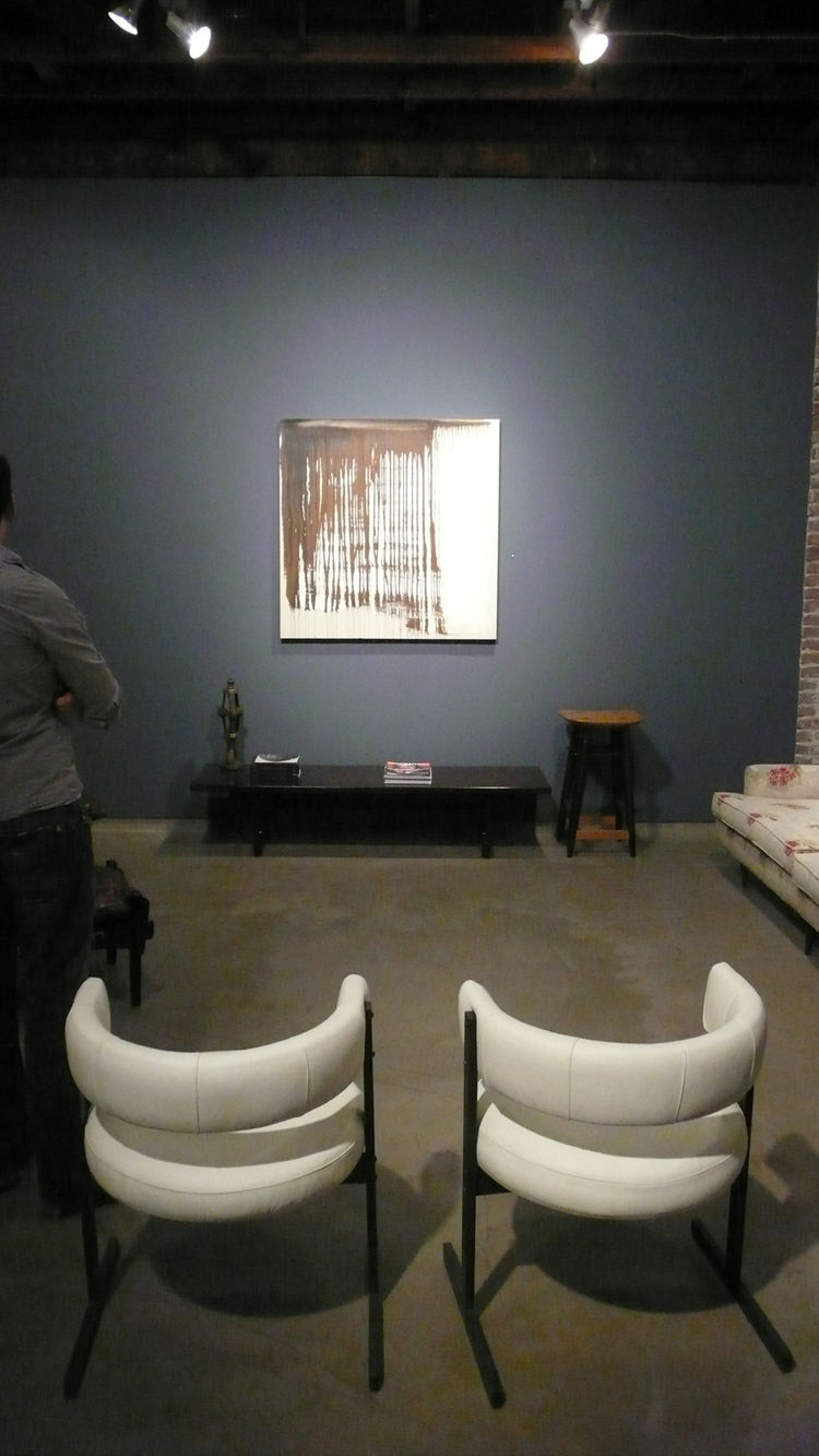 1960s bronze sled chairs in white leather by Jorge Zalszupin before <i>Passage</i>, 2010, by Jason Fitzmaurice.