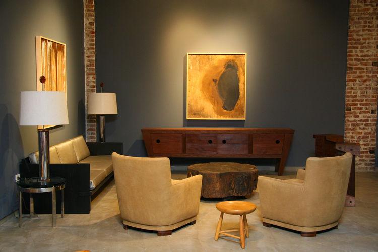 Furnishings by Sergio Rodrigues, Joaquim Tenreiro, Zanini de Zanine Caldas with art by Jason Fitzmaurice.