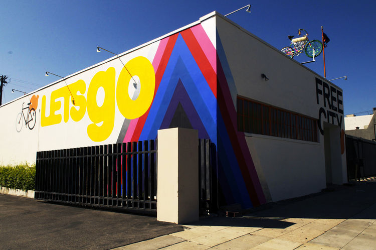 Free City's facade is emblazoned with a colorful, graphic mural by the artist Margo Victor.
