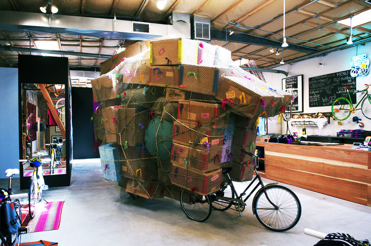 A defining feature of the shop is a pair of sculptures by Free City artist Rick Frausto. This is his 'Box Bike,' inspired by tuk-tuks in Thailand.