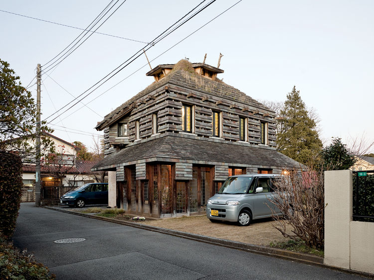 """Fujimori designed his own residence, the Tanpopo House, in 1995, with volcanic rock siding and grass and dandelions on the roof and walls; he is pleased by its """"bushy-haired expression."""""""