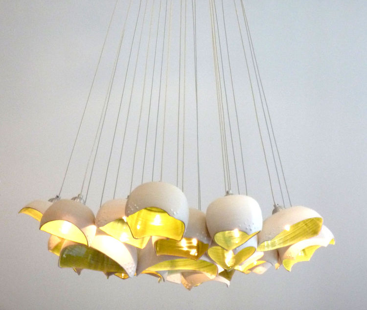 The Barnacle pendant lamp is similar to the Blossom in its inspiration, rendered with a striking yellow glaze inside.<br /><br />Photo by Carol Reach.