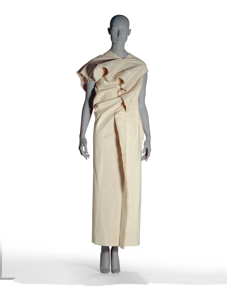 Here's another design by Kawakubo for Comme des Garcons that is defined by a series of slots that once filled create a splendidly textured garment. The dramatic draping is made with twenty sheets of beige binding. It's from the Spring/Summer 1998 collecti