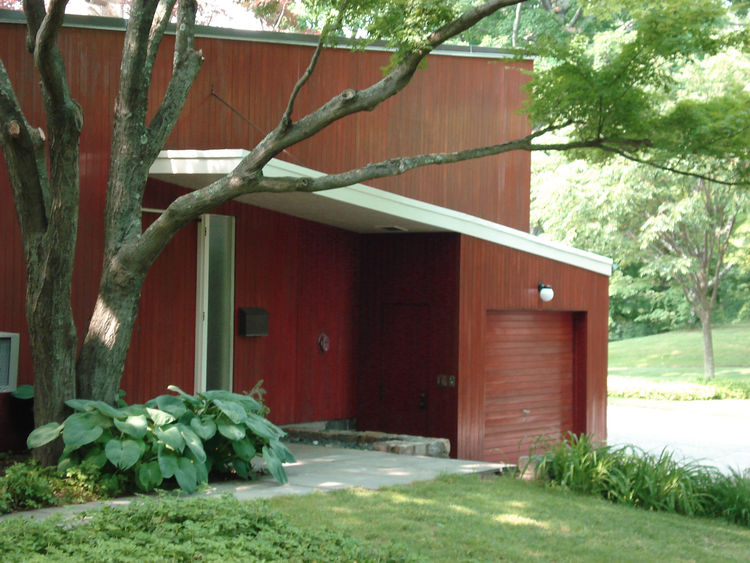 "The garage was extended four feet from the base of the house. The white overhang, which appears to rest atop the garage, originally looked like it ""floated"" on the side on the house. Photo courtesy of the Rockefeller Brothers Fund."