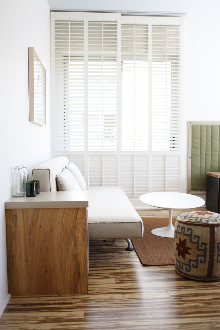 Suites have a sitting area with a Design Within Reach daybed; Saarinen tables; hassocks made from recycled Kilim rugs; and handmade rugs woven in Ukiah. The floors in all the guest rooms are woven strand bamboo, chosen for its durability. Glasses made fro