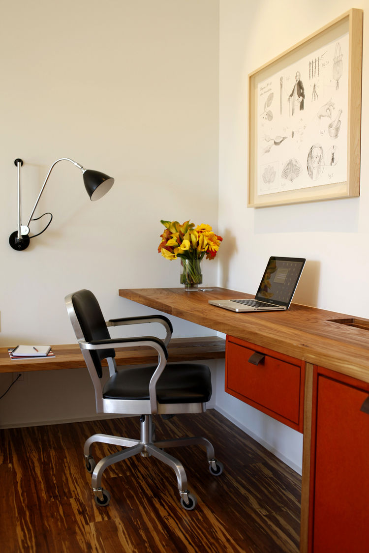 Every room and suite has a streamlined work area. The wall-mounted desk is made from American Elm salvaged by the local company Alborica. The drawers and cabinets are made from Valchromat, an organically tinted wood fiber board manufactured from forest wa