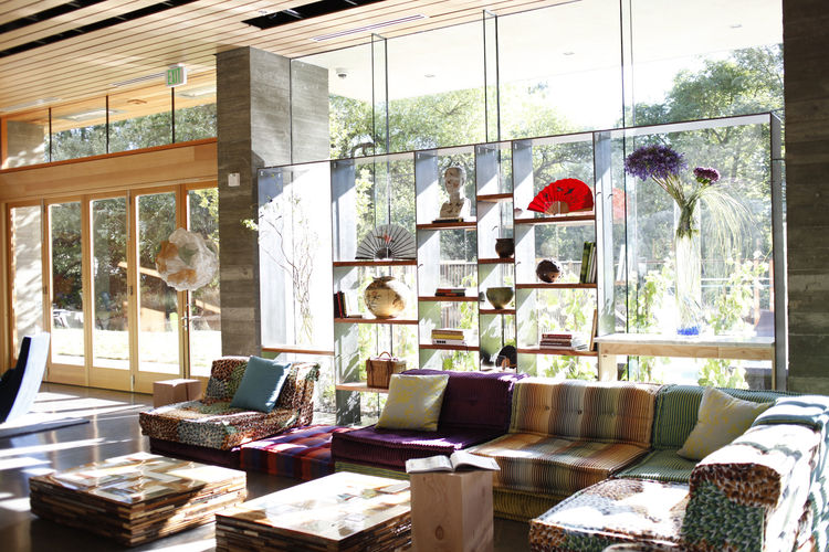 "The lobby ""chill space"" is decked out with Roche Bobois Mah Jong modular seating in Missoni and Kenzo fabrics. The 'Waste Coffee Cubes' by Piet Hein Eek are made from scrap wood. Underfoot are fair-trade felt rugs from Peace Industry, made from lambswool"