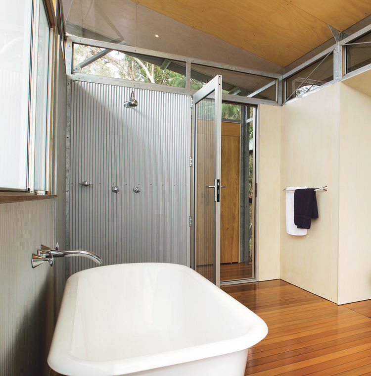 In Australia's Northern Territory, architect Sue Harper conceived a prefab structure comprised of three pavilions joined by suspended walkways. For the master bathroom, she clad the walls in steel. Harper and her husband, Andy Irvine, used BlueScope's Zin