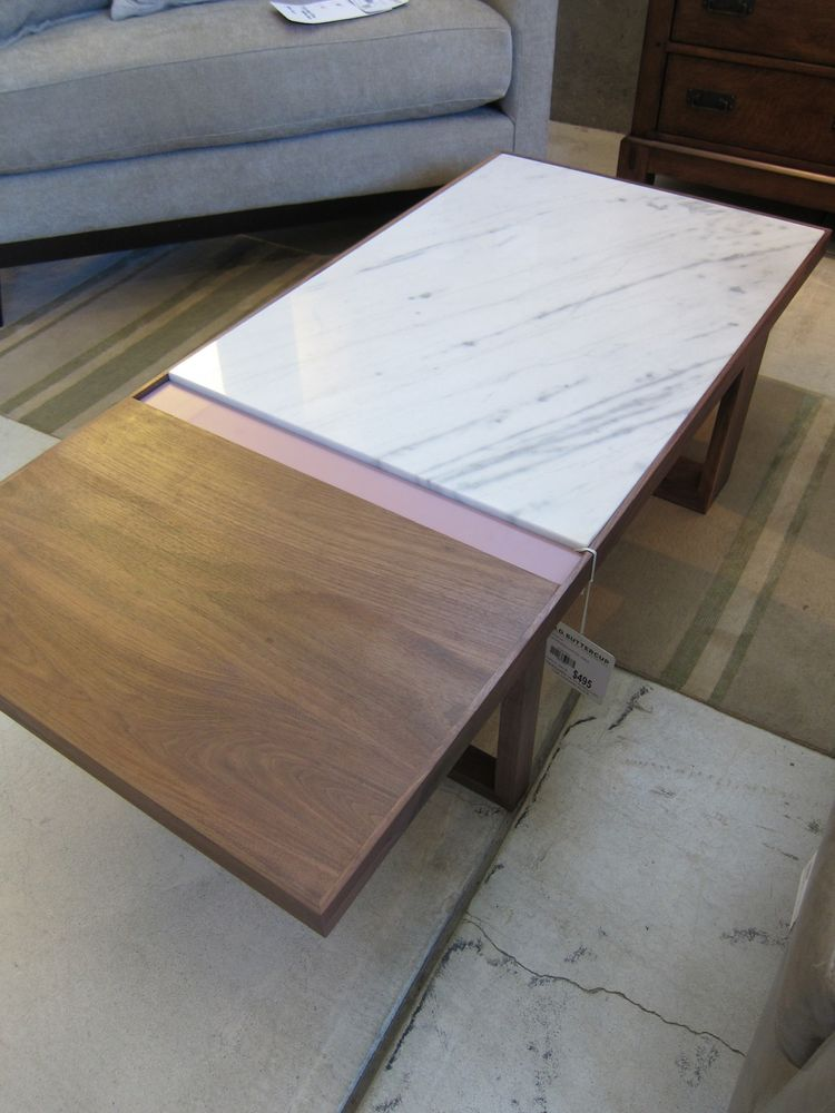 I am rather smitten with this wood-and-marble coffee table.