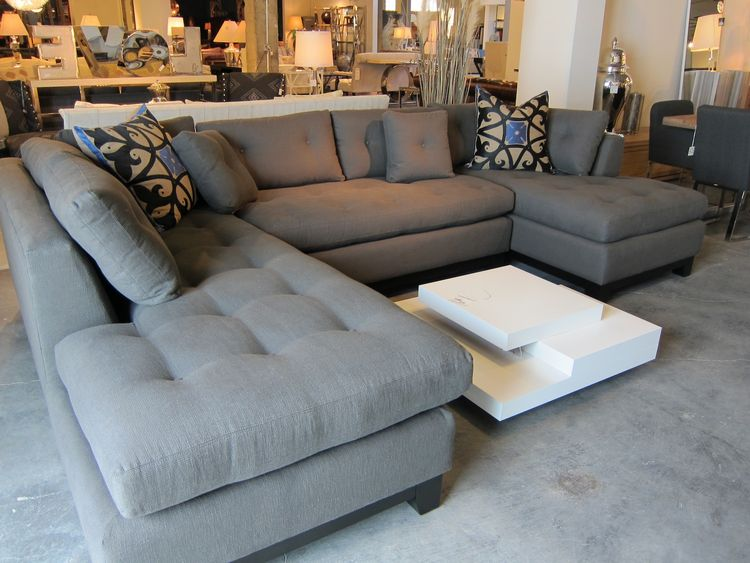 Here's a nice-looking sectional, priced at $3,795. I'd lose the patterned pillows.