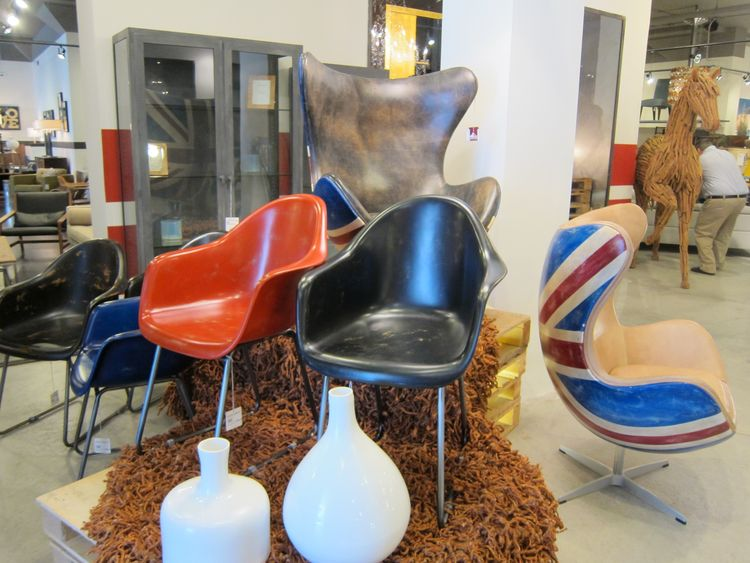 Also at the entrance to the shop: an assortment of vaguely Eames-ian and Egg-like chairs...