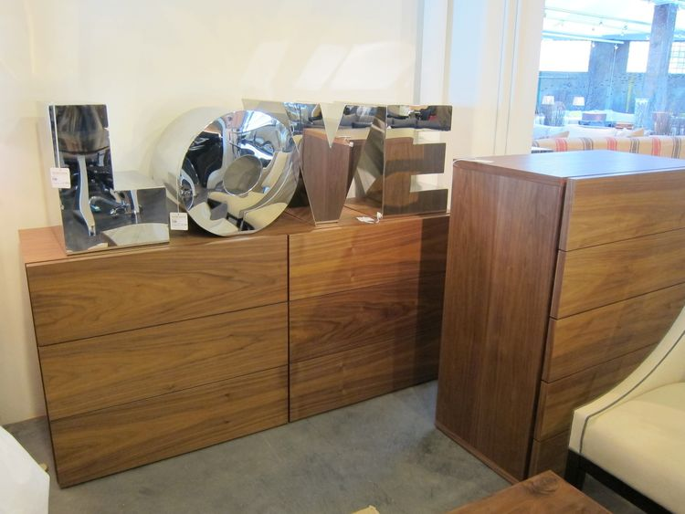 I also like the clean lines of these Walnut dressers. The wide six-drawer version retails at $1,395.