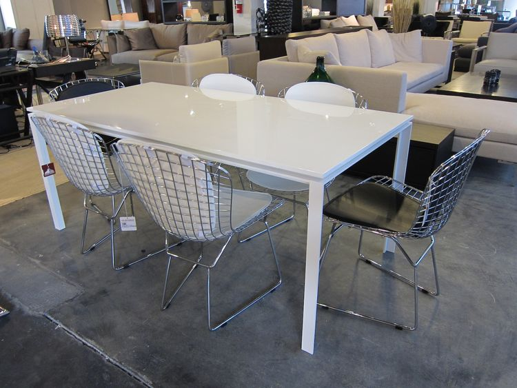 Faux Bertoia dining chairs for $150.
