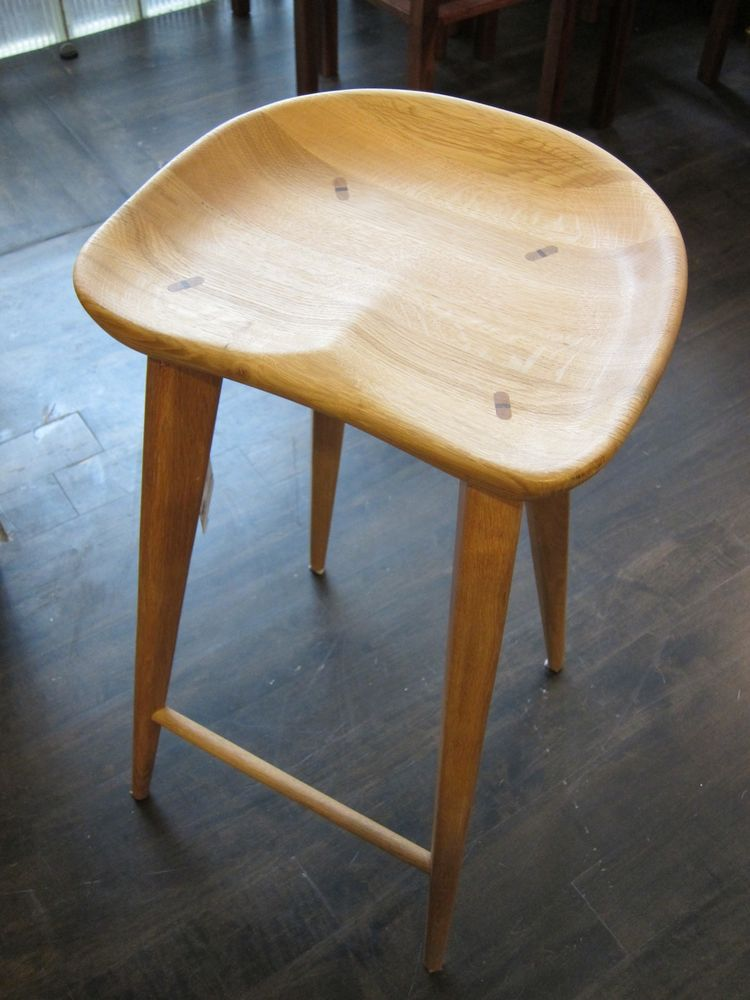 """This is the piece that initially drew me in. I spotted this wooden stool at a friend's house and thought it was the <a href=""""http://www.dwr.com/product/dining/chairs/barstools-counter-stools/tractor-barstool.do?sortby=ourPicks"""">Tractor Barstool</a> by Cra"""