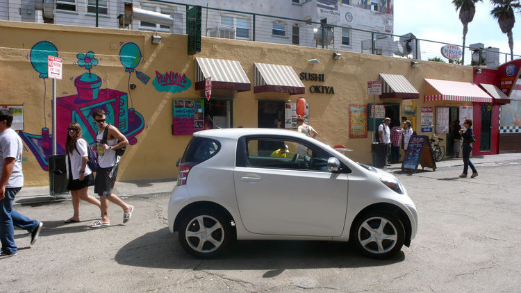 Despite its diminutive appearance, the iQ seats four and is especially roomy up front.