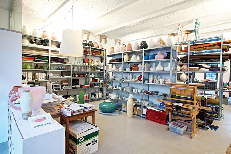 Although Jongerius insists she had a major clear-out before leaving Rotterdam, her studio in Berlin is as packed as ever. Note the Ikea PS Jonsberg vases on the top row of shelves, each made using a different ceramic technique, with ornamentation inspired