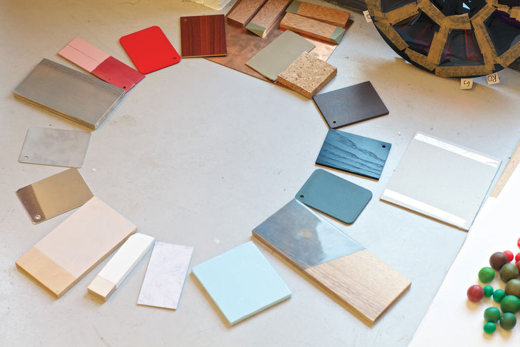 A chromatic composition in progress includes an array of cards from the color system she devised for Vitra, ceramic samples, and other more obscure items.