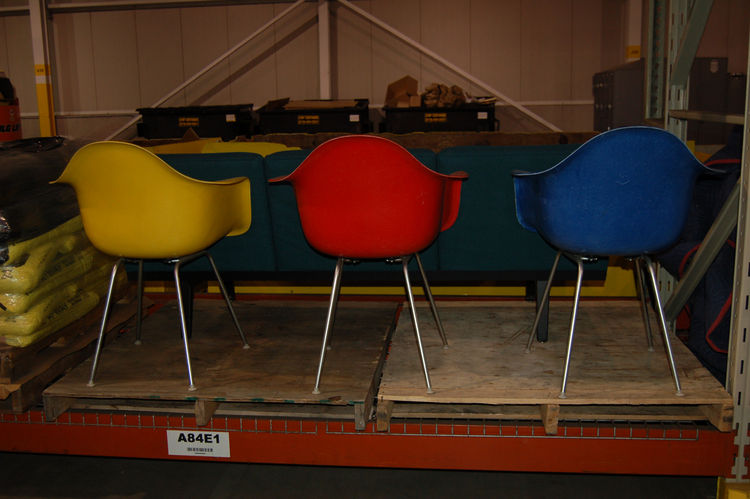 "We headed over to a big warehouse space to look for hidden gems. Here we see a trio of vintage <a href=""http://hermanmiller.com/Products/Eames-Molded-Plastic-Chairs"">Eames Plastic Arm Chairs</a>, which were first produced in 1950. The Eames first introduc"
