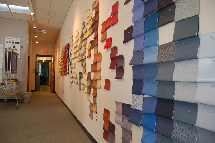 "Inside the colors and materials studio, a wall reflects a work in progress: grouping the existing textile collection into color families that progress from warm to cool and light to dark. ""Textiles are the poster children for color,"" says Lyon. ""With text"