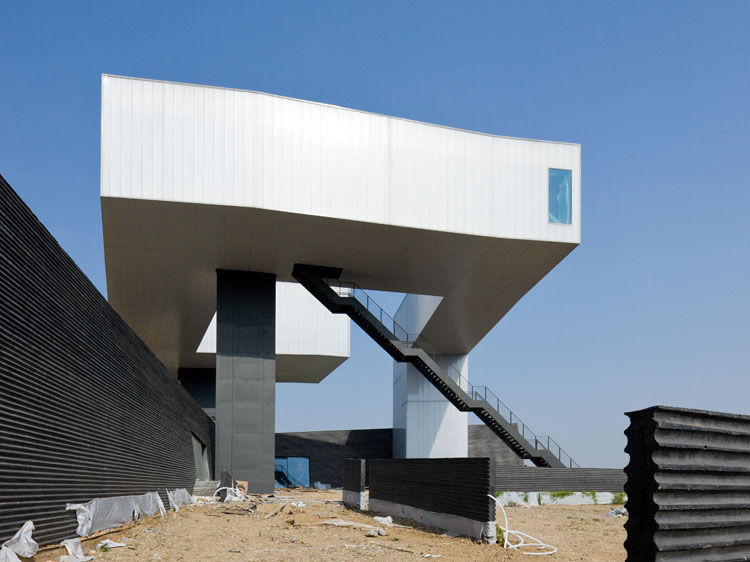 "As yet another variation on traditional concrete walls, <a href=""http://www.stevenholl.com/project-detail.php?type=museums&id=56&page=0"">Steven Holl</a> uses a formwork of bamboo to cast these dark ribbed boundaries to frame the Nanjing Museum of Art and"