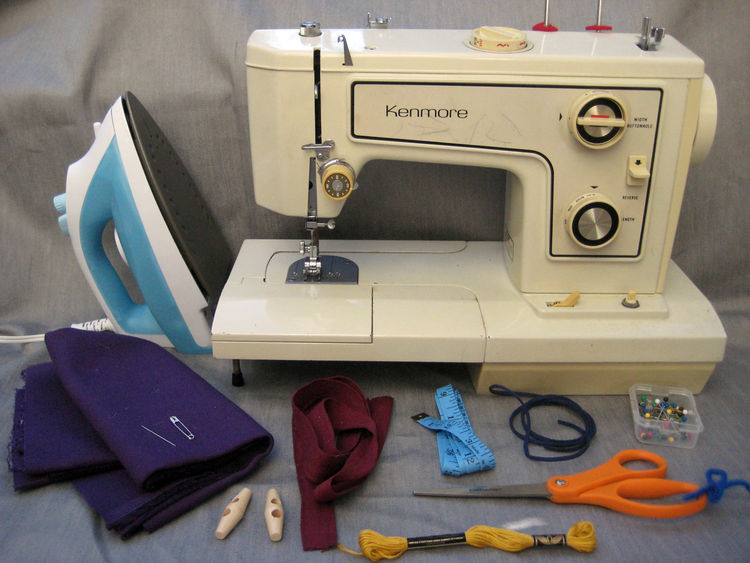 Here are the materials you need to make it happen:<br /><br />-iron<br /><br />-sewing machine<br /><br />-straight pins<br /><br />-scissors<br /><br />-approximately 1/4 yard faux suede cord (it's the blue one there)<br /><br />-embroidery thread<br /><