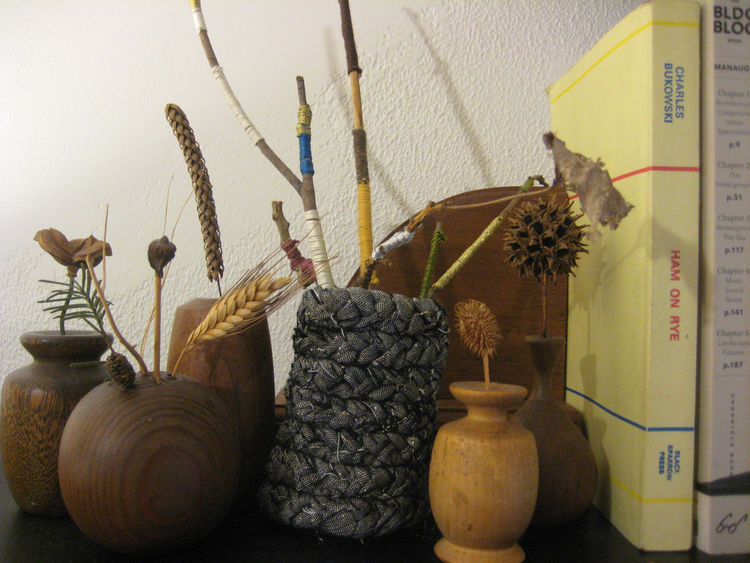 And here's my little mantle tableau. I put some twigs wrapped in embroidery floss in there for a bit of color, and surrounded it with some wooden bud vases that my grandpa made. Lookin' good! This project was seriously perfect for a drizzly afternoon indo