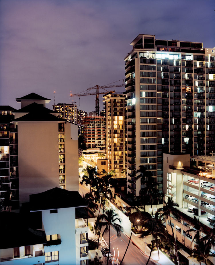 A crane-dotted night sky over Waikiki's condos and hotels attests to the city's recent building boom, as developers rush to accommodate the area's teeming 4.5 million visitors per year.