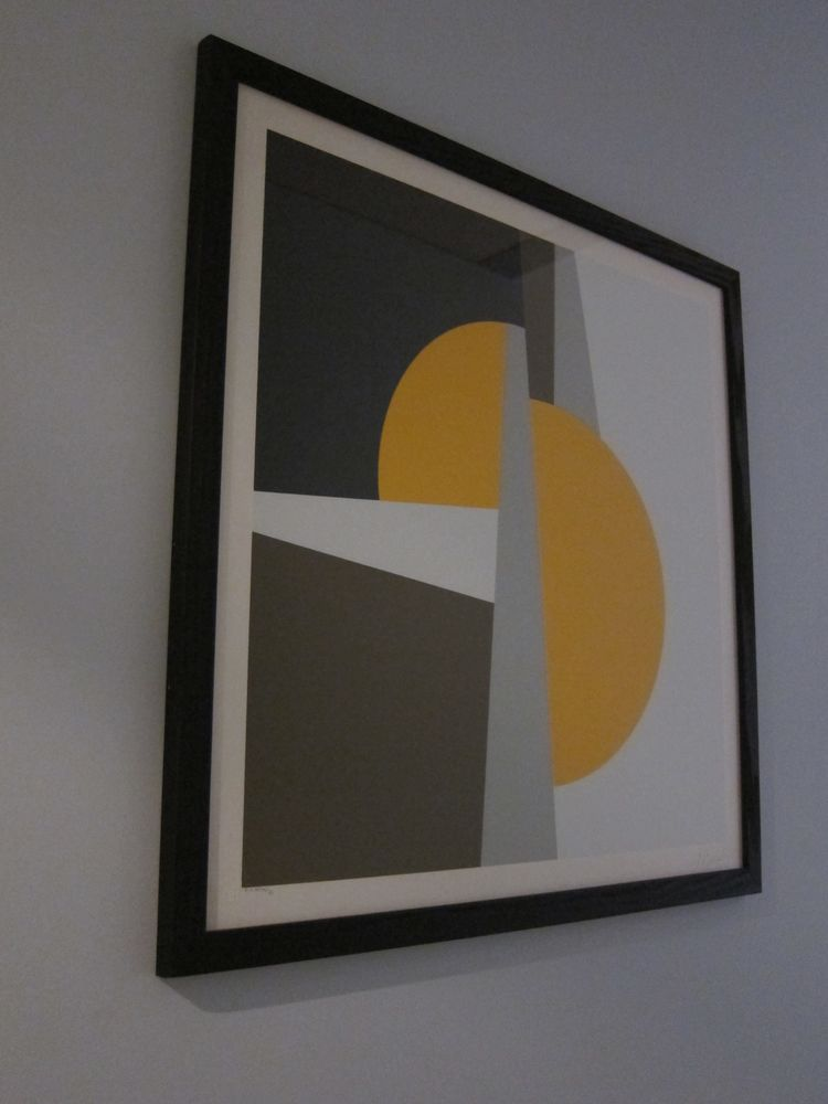 I liked this framed graphic print on my wall, a print from the 70's. Each room has an original piece of art on the walls.