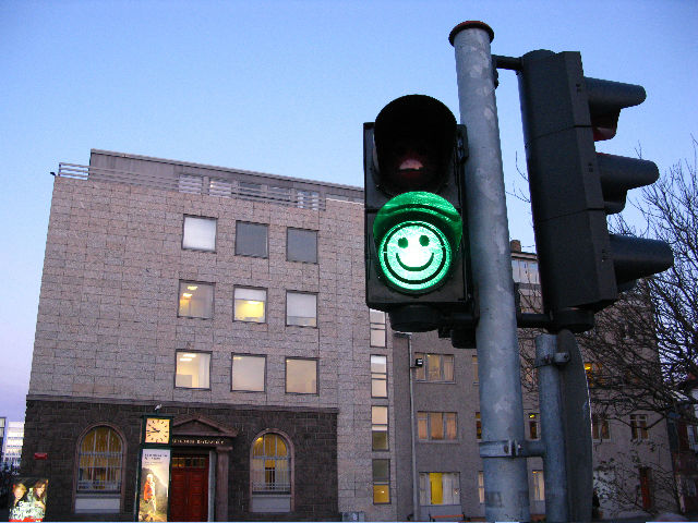 Experience design with a smile in a crosswalk.