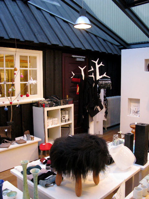 """Many tourist shops tout """"Icelandic design,"""" but none curate it quite like<a href=""""http://kraum.is/"""">Kraum</a>, located in the oldest house in Reykjavik (built in 1762.) Front and center here is the Fuzzy footstool designed bySigurður Már Helgason in 197"""