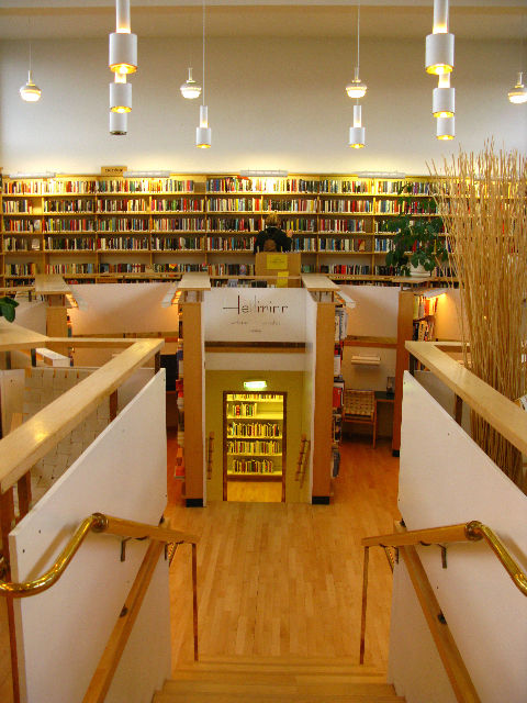 """This library is the warm center of Finnish architect Alvar Aalto's <a href=""""http://www.nordichouse.is/"""">Nordic House</a>, built in 1968."""