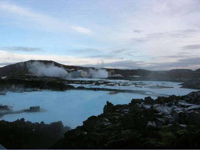 """The<a href=""""<a href=""""http://en.wikipedia.org/wiki/Svartsengi_Power_Station""""> Svartsengi </a>geothermic power plant (in the background) looms over lava fields and feeds the large Blue Lagoon swimming area. The plant's runoff, heated by lava to hot-tub-pe"""